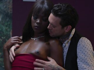 Ebony beauty rides man's cock in pure predilection