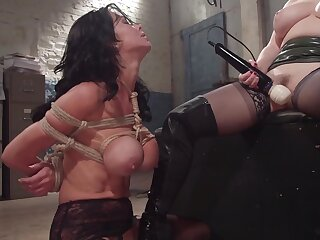 Busty MILF dominates a sensual bombshell and ties her adjacent to