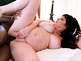 Busty curly unilluminated with big Bristols fucks on couch